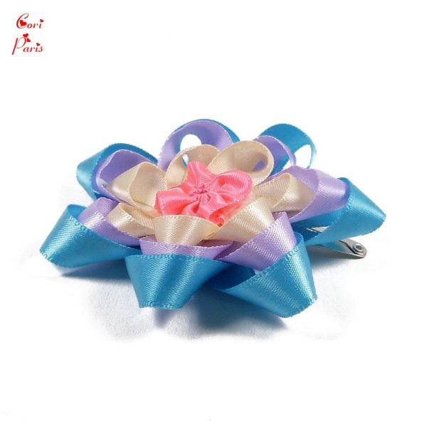 Barrette hair clip with a large blue flower for a baby girl or a toddler