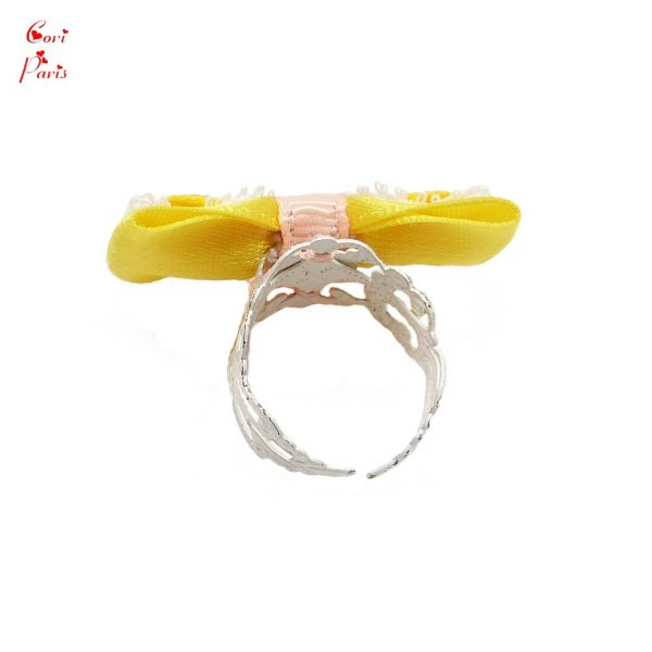 Cori Paris - Jewelry for a new mom, a yellow ring on an adjustable white ring.