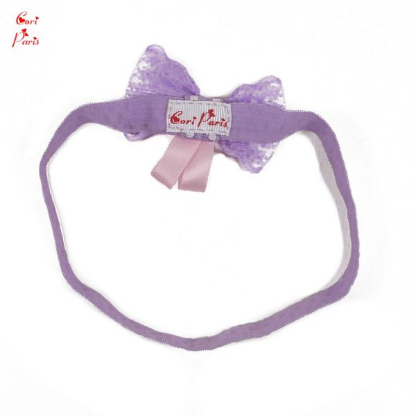 Baby headband with bow in purple color, a stylish baby hair accessory