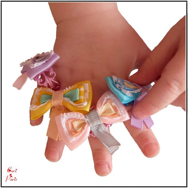 Cori Paris - Collection of bow rings for women, a great new mom gift idea.