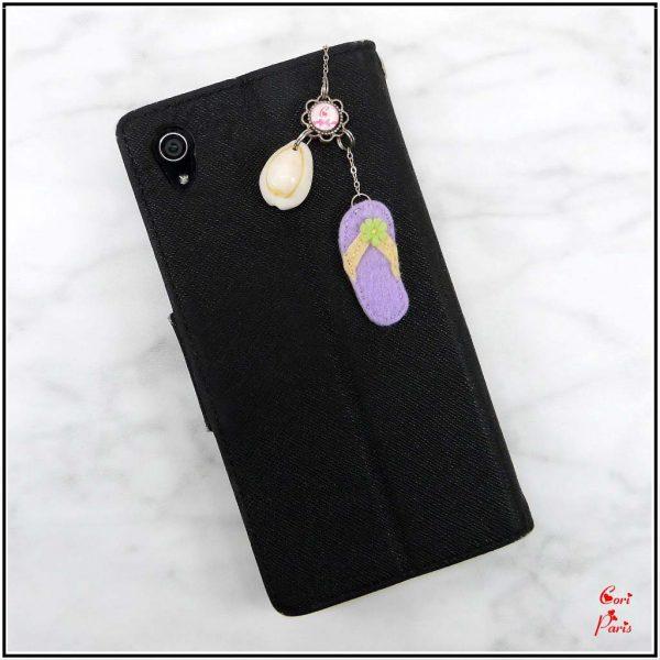Anti dust plug charm, headphone jack plug representing a shell and a purple felt flip-flop