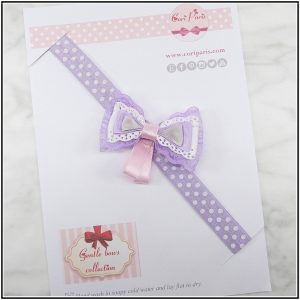 Baby bow headband in purple color for a stylish baby girl