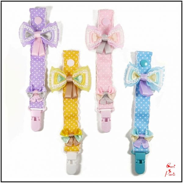 Baby dummy clips collection with bows in purple, yellow, pink and blue