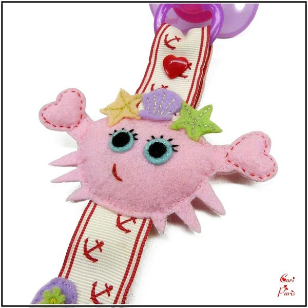 Baby dummy clip with pink crab, cute baby beach accessory from CORI PARIS.