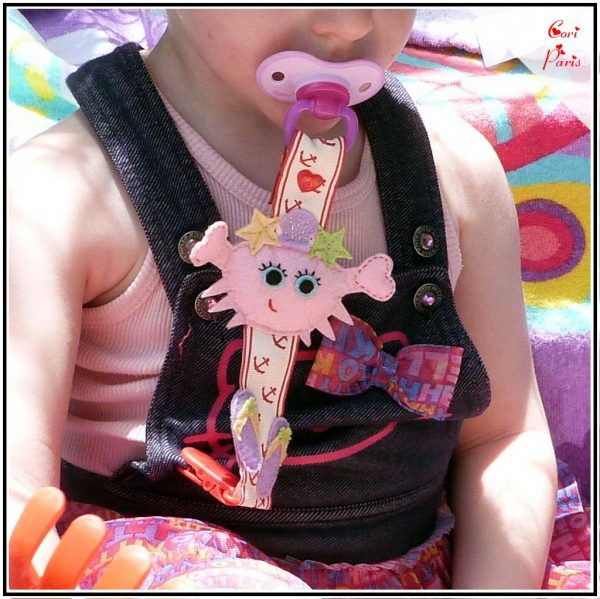Baby dummy holder with pink crab, cute baby beach accessory from CORI PARIS.