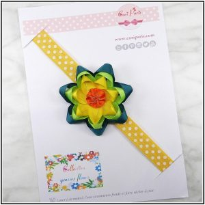 Baby girl headband with a large yellow flower from Cori Paris