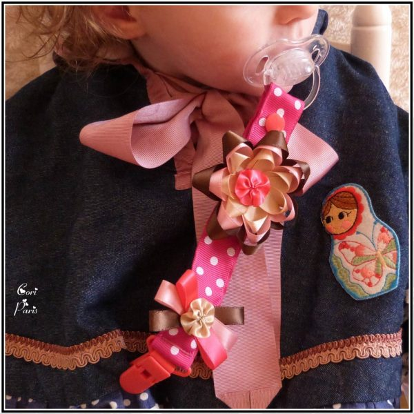 Baby pacifier clip with large ribbon flower, a nice baby girl gift idea