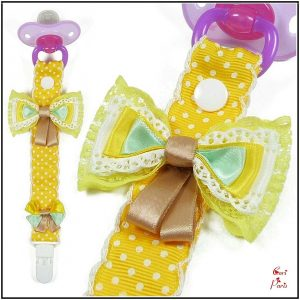 Baby pacifier holder with yellow bows from Cori Paris, yellow pacifier clip