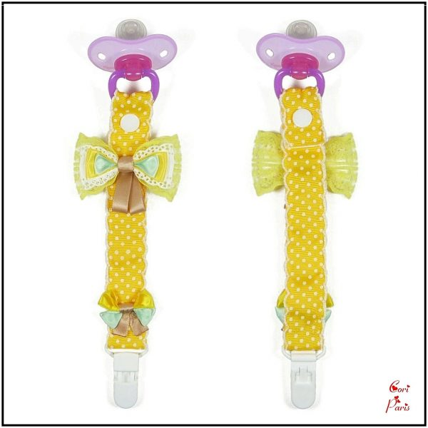 Good baby shower gift, a cute pacifier clip with yellow bows.