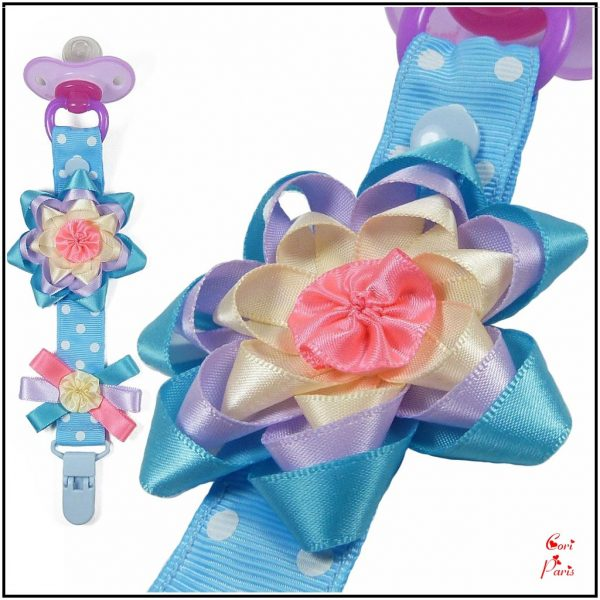 Binky clip with a ribbon flower, blue pacifier holder from CORI PARIS