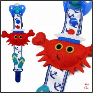 Boy pacifier clip with a red crab, summer newborn dummy from CORI PARIS