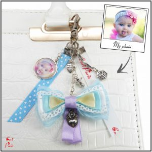 Cute bag charm with a blue bow and personalized with a photo