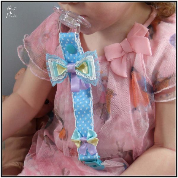 Baby gift for girl - a blue bow pacifier clip for a trendy baby girl.