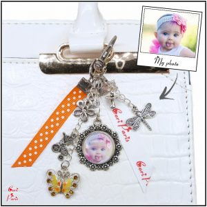 Personalized flower keychain in orange color with your photo and cute baby charms
