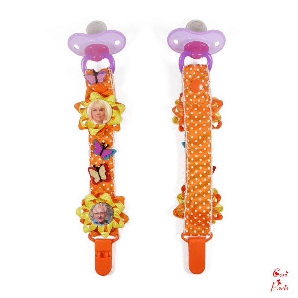 Personalized pacifier clip with butterflies and flowers in orange color from CORI PARIS
