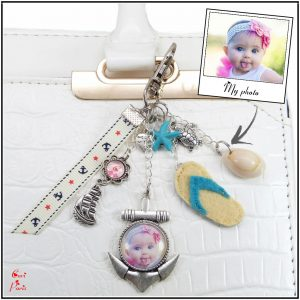 Personalized shell bag charm with charms, a boat, seashells and a yellow flip flop