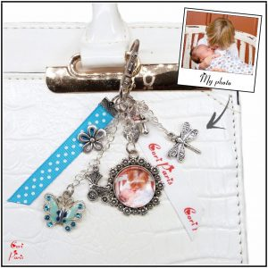 Personalized zipper charm with a blue butterfly charm and a custom cabochon with your picture