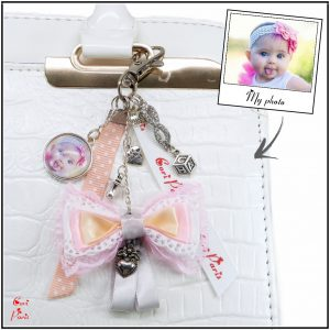 Cori Paris - Women accessories, a unique personalized bag charm with a pink ribbon bow.