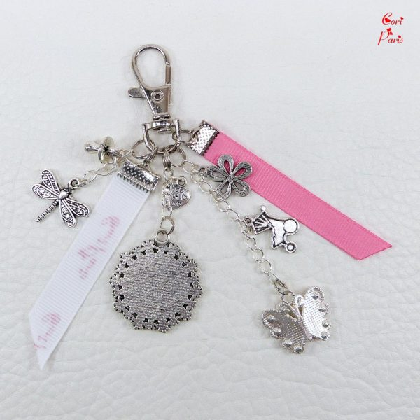 Pink purse charm with a charm butterfly, a great gift for a mom to be