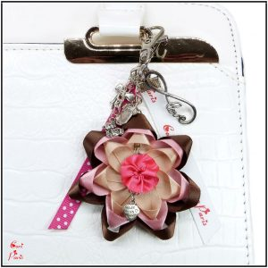 Purse charm with a large pink and brown flower, fashion woman accessories
