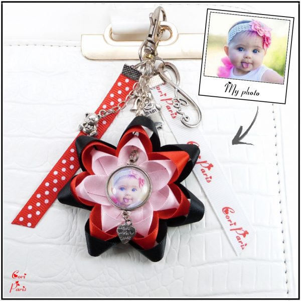Custom photo keychain with baby charms and a ribbon flower, a fun gift for mom