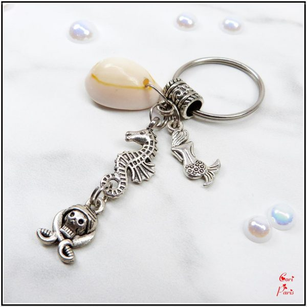 Seahorse keychain with a natural shell and a seahorse, mermaid and pirate skull charms