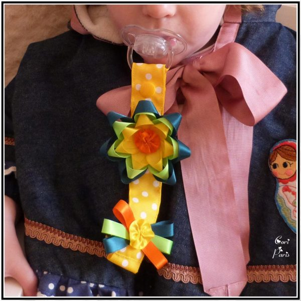 Soother holder with a large ribbon flower, yellow pacifier holder from CORI PARIS