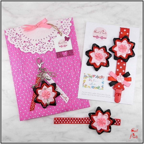 Unique new mom gifts including a pacifier clip, baby girl hair accessories & a bag charm