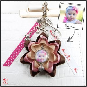 Personalized keychain with photo, a large ribbon flower and cute bag charms from Cori Paris
